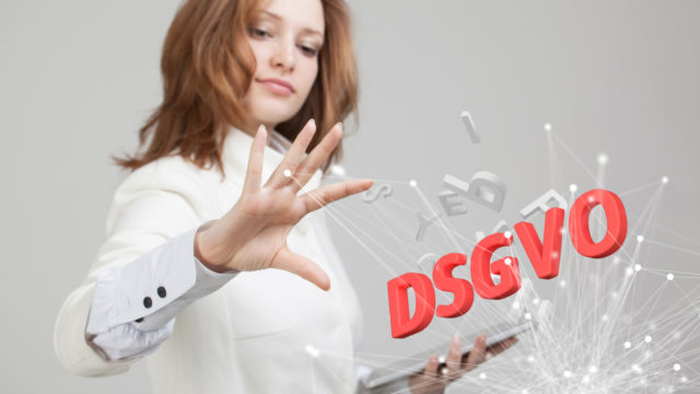 DSGVO, german version of GDPR, concept image. General Data Protection Regulation, the protection of personal data. Young woman working with information. Datenschutz-Grundverordnung.